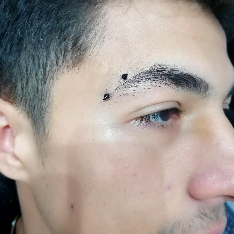 horizontal,black,eyebrow,piercing